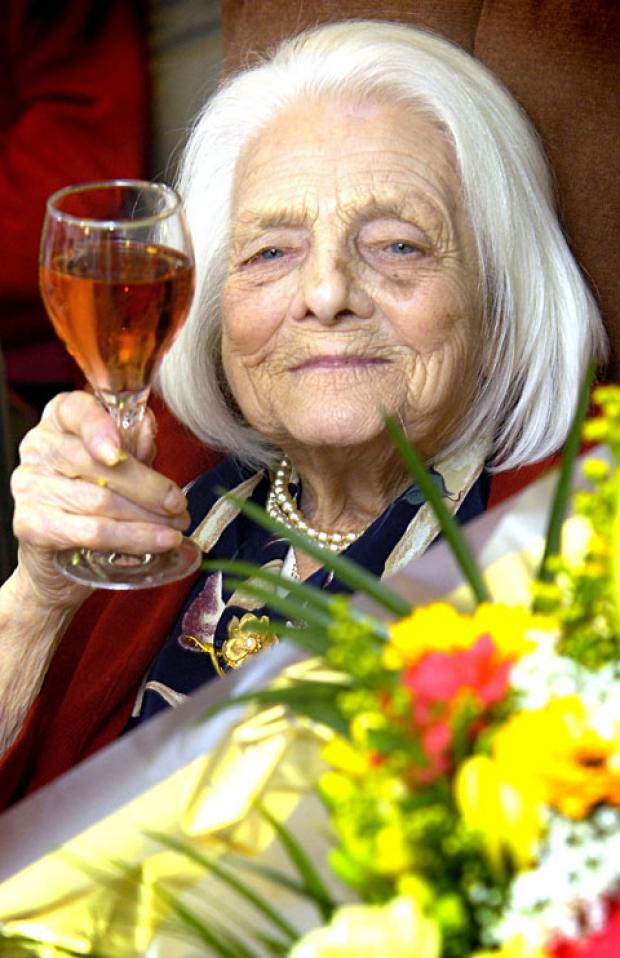 CHEERS: Elizabeth Mills toasts her 101st birthday at Ravenhurst Rest Home, Stourport.