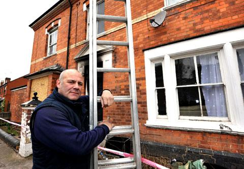 HERO: Plucky window cleaner Darren Bullock, who once played for Worcester City, uses his ladder to rescue a man from the blaze. Picture by John Anyon. 0913258201