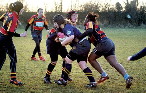 ON THE ATTACK: Worcester's Megan Willoughby bulldozes through the opposition as the under 15s charge towards the North Dorset Sevens title.