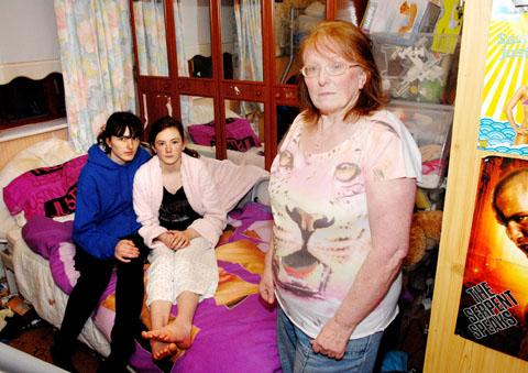 OVERCROWDED: Denise Taylor with her granddaughters Kirsty, aged 18, and Hannah, 13.