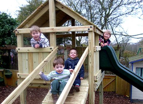 WAIT IS OVER: The new climbing frame replaces one stolen last year and is enjoyed by pupils, from left, Samuel Roberts, Charlie Parkes, Jack Stoker and William Browne.