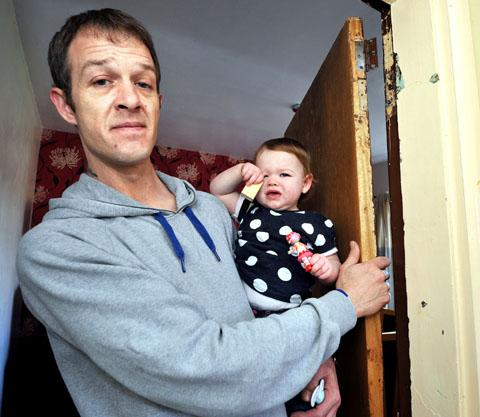 DOOR UNHINGED: David Paterson with 12-month-old daughter Elle-Louise. 1113268101