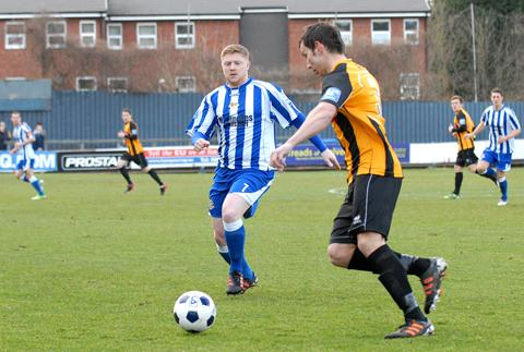 CHARGING DOWN: Worcester City's Matt Birley (left) tries to win the ball back against Boston.
