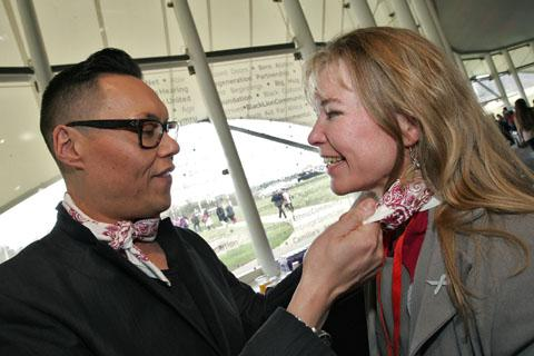 STYLE GURU: Bridget Dowty has her bandana fitted by fashonista Gok Wan at the launch.