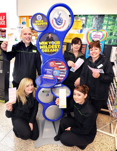 THAT'S JUST THE TICKET:  Co-operative staff, left to right front, Stacey Jones and Katy Ellis with, back row left to right, Craig Pall, Kath Bullock and Bev Hands celebrate the big lottery win which happened at their store.