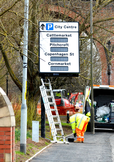 GOING UP: One of the new electronic signs is installed  in Hylton Road to direct  drivers to available parking spaces in Worcester city centre.