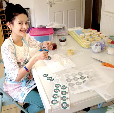 SURPRISE: Bella Seaton-Smith, 11-years-old, making Royal Engineer cap badge cup cakes.
