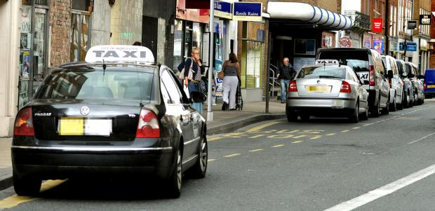 Taxi drivers at Foregate Street, in Worcester