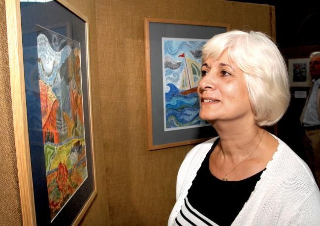 COLOURFUL DISPLAY: Maria Heaney looks at the Hannah Dunnett More Than Words water colour exhibition which is being held at Worcester Cathedral as part of this year's festival.