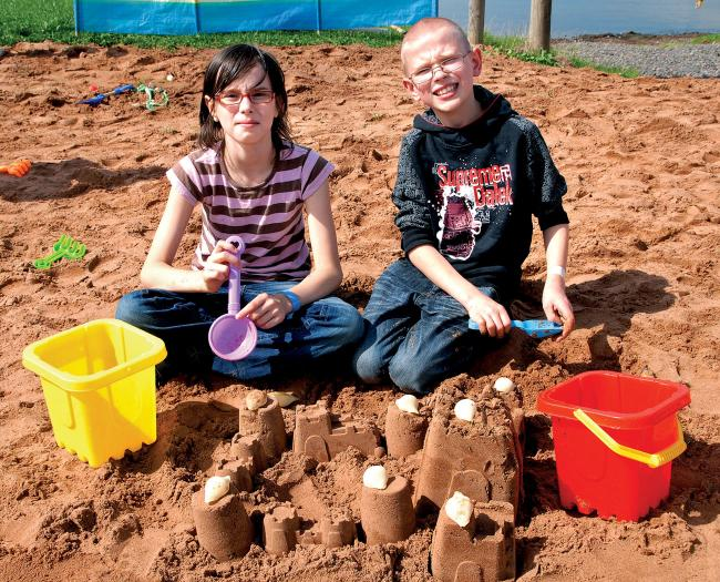 BEEN TO THE BEACH: Abi Jelley and Bob Jelley, both aged 10, enjoying a day at the 'seaside' at Top Barn Farm, Holt Heath. 3413389101