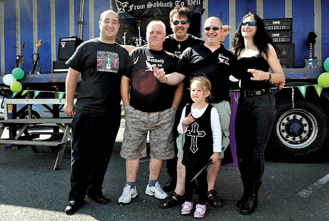 ROCKING OUT TO HELP BEAT CANCER: From Sabbath to Hell are, left to right, Ryan Macdonald, Steve Farley, Jon Payne, Colin Smith and Kirsty Pollock with young fan Ruby Smith. The concert sparked complaints.