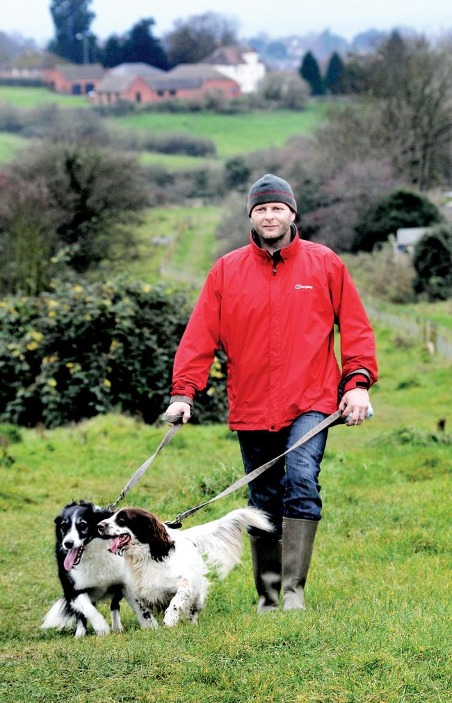 Gulf veteran Chris Davies takes a nervous stroll with his dogs Maisey and Flynn in Ronkswood park. Picture: John Anyon. 50134770001