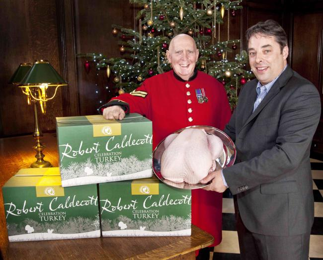 BEST OF THE BREAST: Chelsea Pensioner Dave Thomson gratefully accepts  a Christmas feast from farmer Rob Caldecott.