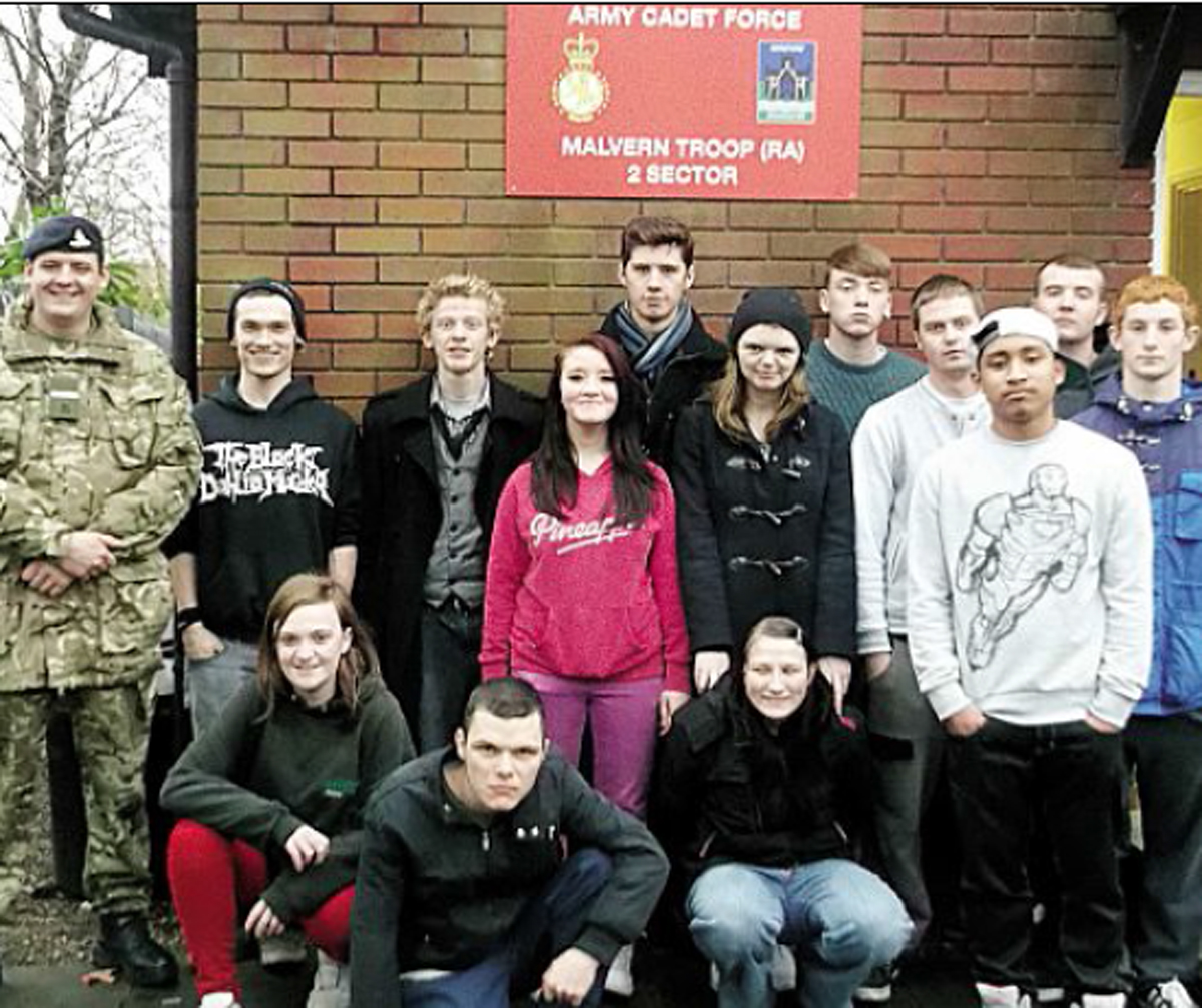 WORKING WITH A WILL: The team of unemployed youngsters who raised cash to revamp the Army Cadets' headquarters.