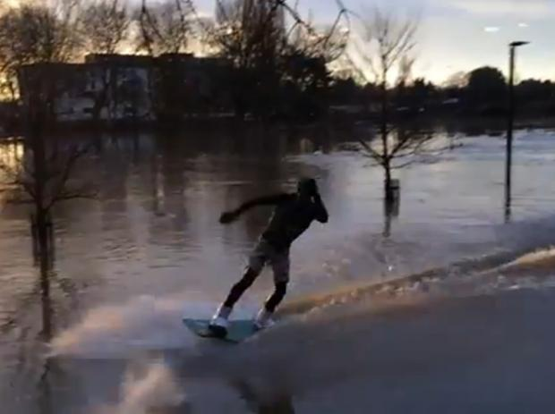 The wakeboarder takes to the Severn floods in Worcester