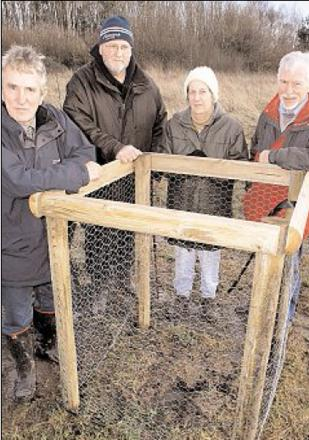 DEVASTATED: Volunteers after the first theft at Aconbury Orchard at the spot where one of the trees had been planted, from the left, Councillor Andy Roberts, Dan Robb, Jackie Craddock and Ray Harte.