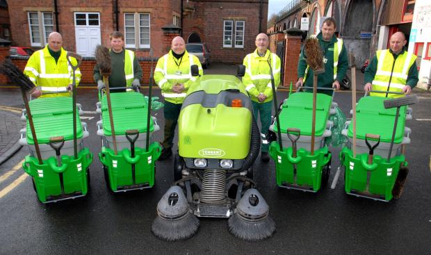 Worcester News: Worcester City Council street cleansing operatives have new kit in the shape of a sweeper and hand barrows.From left are street cleansing operatives Jeff Hendon, Sean Moloney, Chris Collins, John Wakefield, Ken Thomasson and Andrew Johnson. Pic by Paul Ja