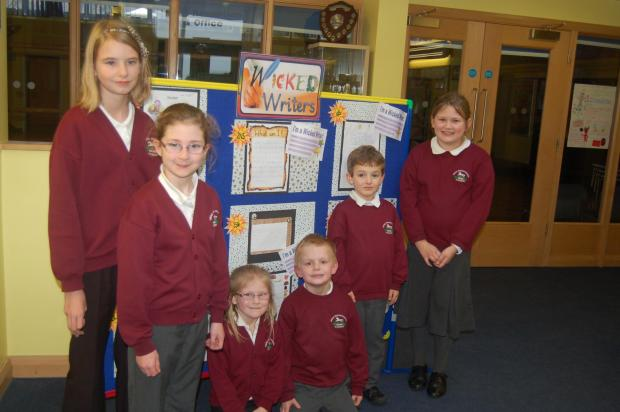 Writing day at The Grove Primary: Jorja Hand (Year 5) ,  Abigail Arnold (Year 4), Daniel Clay (Reception), Leona Bruce (Reception Class), Morgan Mitchell         (Year 1), Hollie-Bryant Jones (Year 5).