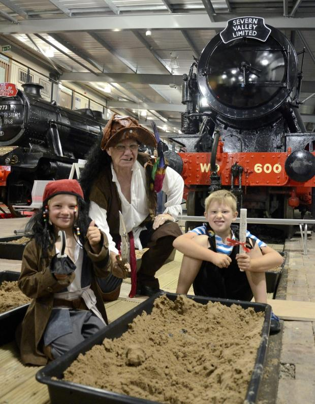 Worcester News: William Murdock, aged seven, Charlie Murdock, four, and 'Captain' Geoff (Engine House volunteer) enjoying activities at The Engine House in Highley during Pirate Time week as part of the Steam and Whistle activity club last summer.