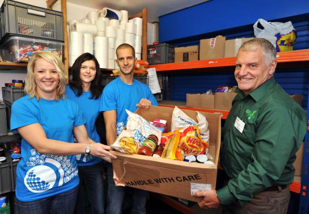 DONATION: Laura Benjamin, Amy Wright and Mike Holloway from Names.co.uk hand over some of the boxes of food they have collected over a week to manager of Worcester Foodbank, Colin Whitehead. Picture by John Anyon (3564643)