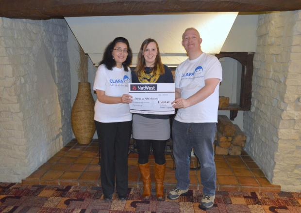 Frankie's parents Lisa Ventura and Russell Ventura hand over their donation to Becky Gowers, CLAPA central England regional coordinator. Picture by Russell Ventura of Furry Apple Photography