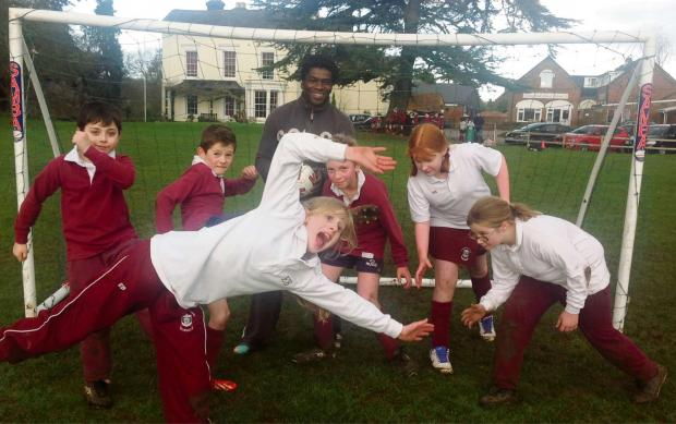 Former England footballer Tony Daley enjoys a game with school pupils