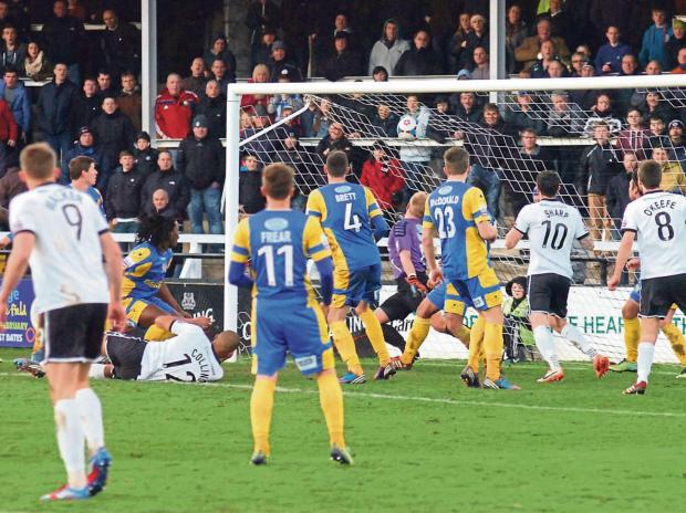 Hereford United defender Dominic Collins scores the winner in the 1-0 victory over Salisbury City.