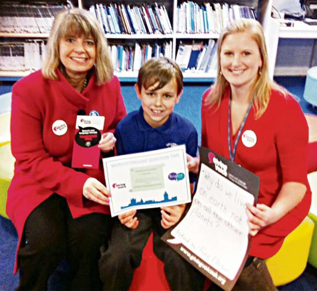 Finn Ellison with (left) Harriett Baldwin MP and speech therapist Charlotte Shireshuck.