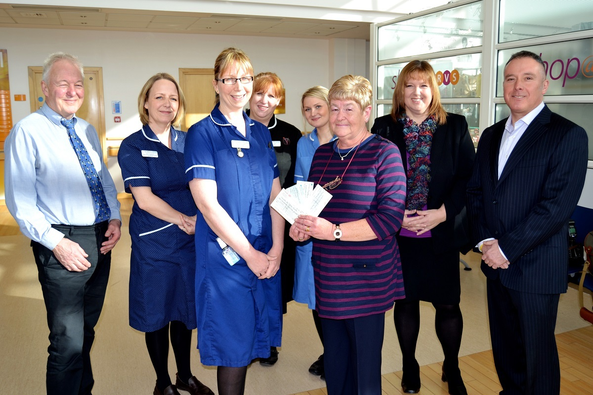 Linda Patrick presents her donation to Junior Ward Sister Kerry Burbidge with con