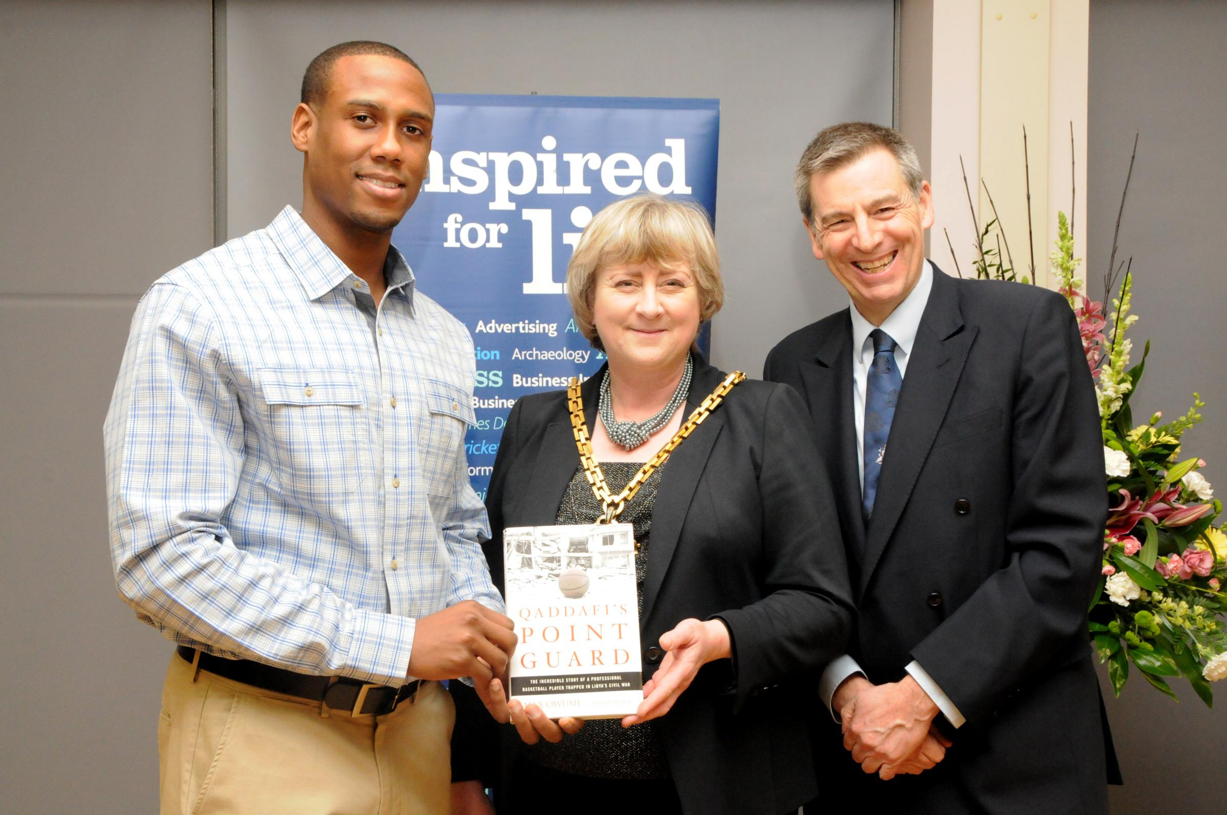 "WORCESTER Wolves star Alex Owumi at the launch of his book, ""Qaddafi's Point Guard"", with Worcester Mayor Councillor Pat Agar and University of Worcester Vice Chancellor Professor David Green."