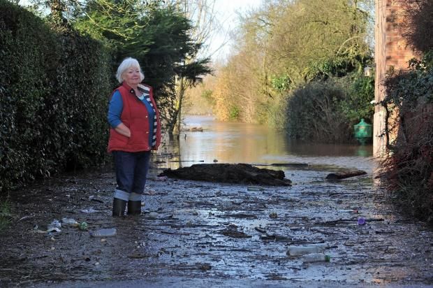 Sue Price, resident of Lanes Ends, Kempsey, surveys the flood water at the bottom of the lane. She is also concerned for the welfare of her friend Jacky Smith who is cut off by the flood water.
