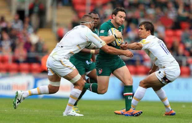 Ryan Lamb, pictured in action against Worcester Warriors' Sam Betty (left) and Ignacio Mieres at Welford Road last September, may not make his debut against Northampton on Saturday.