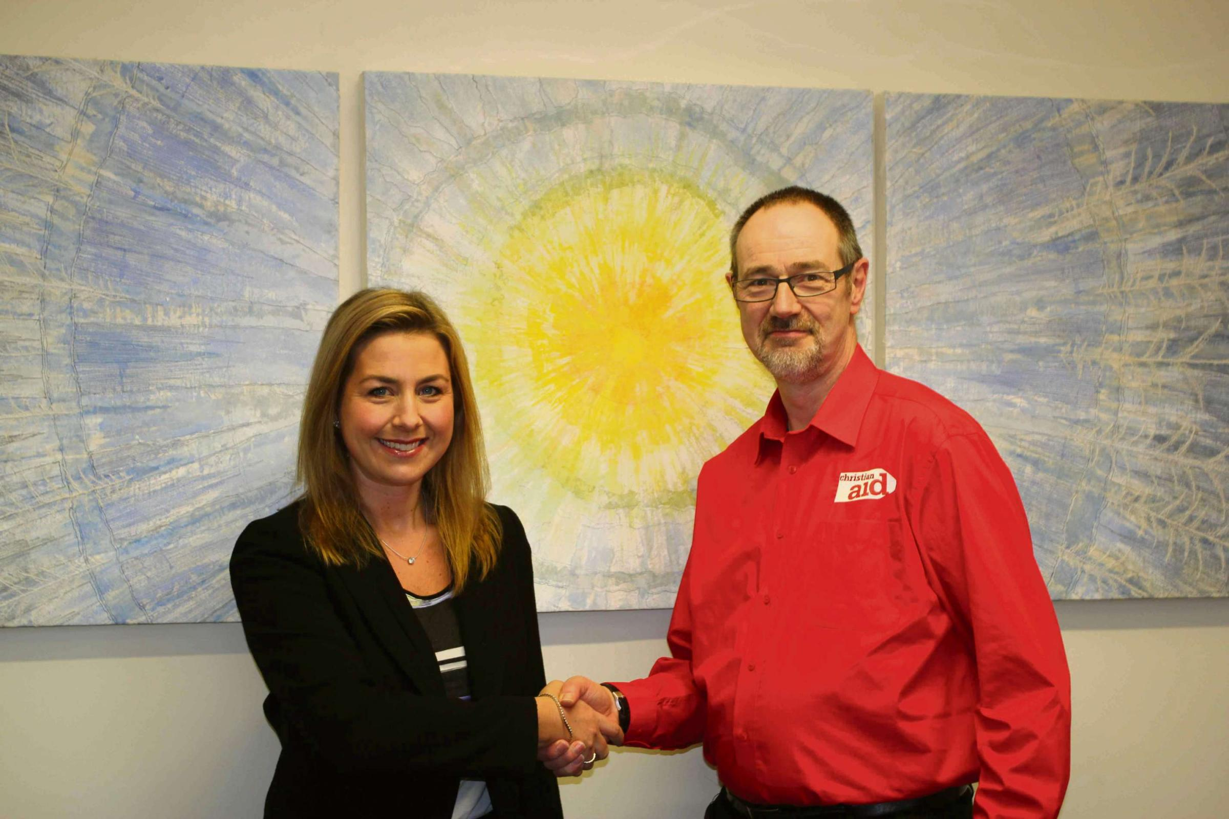 Hayley Sanders, chartered legal executive at Harrison Clark Rickerbys in Worcester pictured with Peter Kelsall, regional legacies officer at Christian Aid after the city firm's donation to Will Aid.