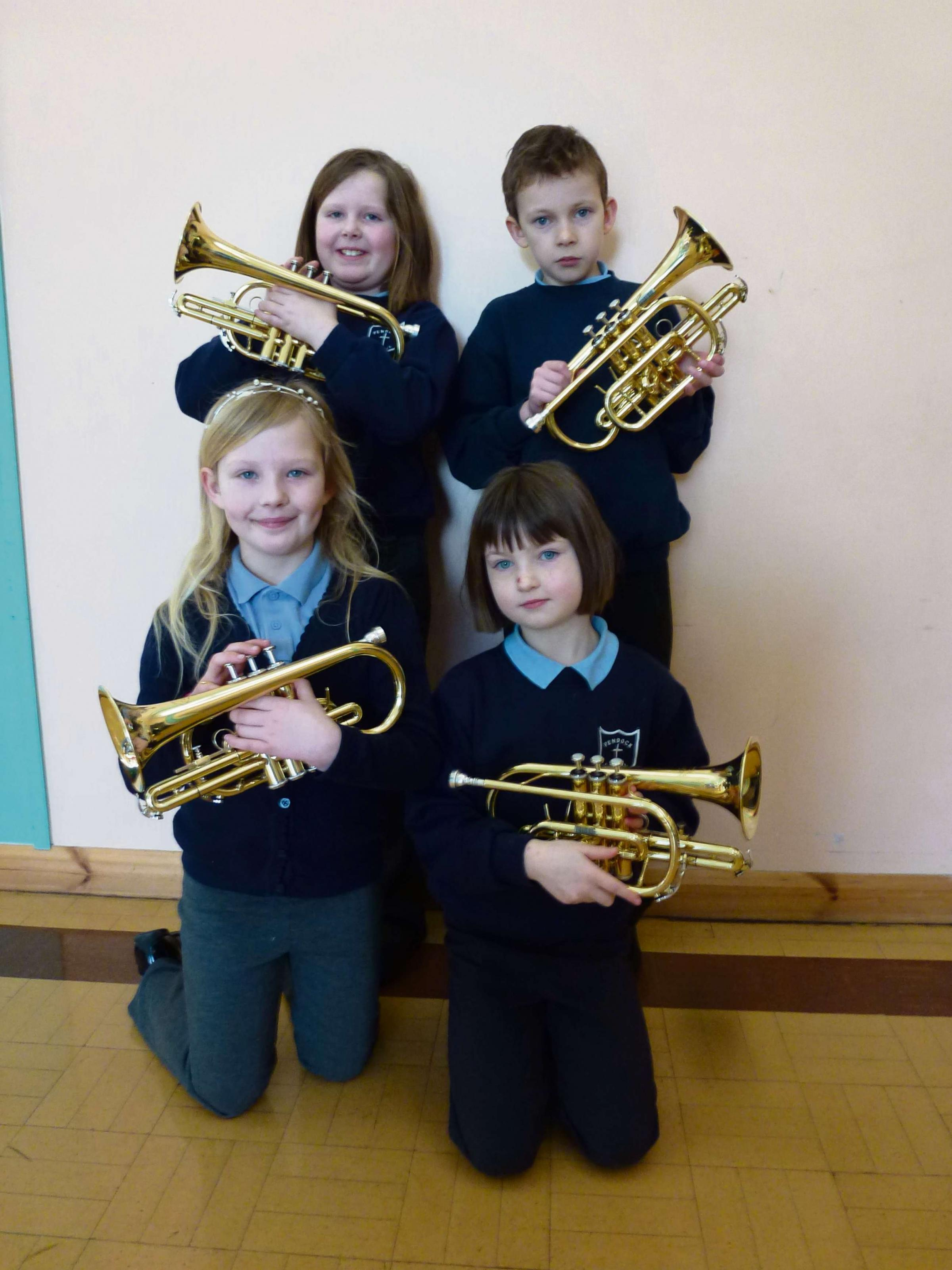 Class two pupils Rosie Goffe, Kitty Hardman, Tirian Ashby and Millie Rousell with their cornets.