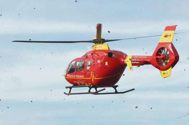 Woman airlifted to hospital after car crash