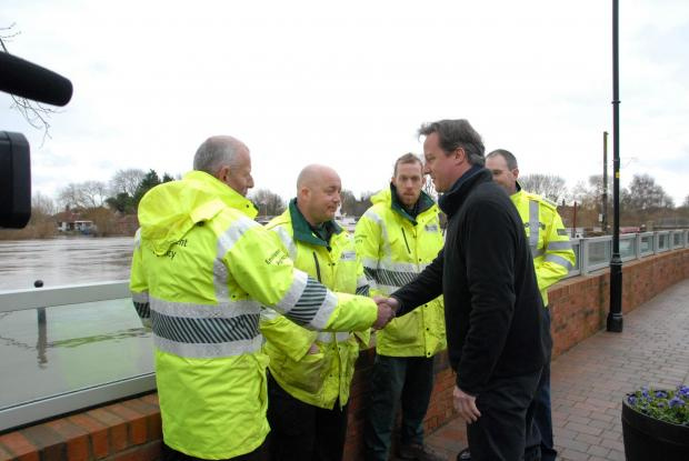 Worcester News: David Cameron during his visit to Upton amid the recent flooding crisis