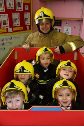Fireman Wayne Berry with Oliver Phillips, Myles Richards, Thomas Godbear, Jessica Owen and Evie Noone. (s)