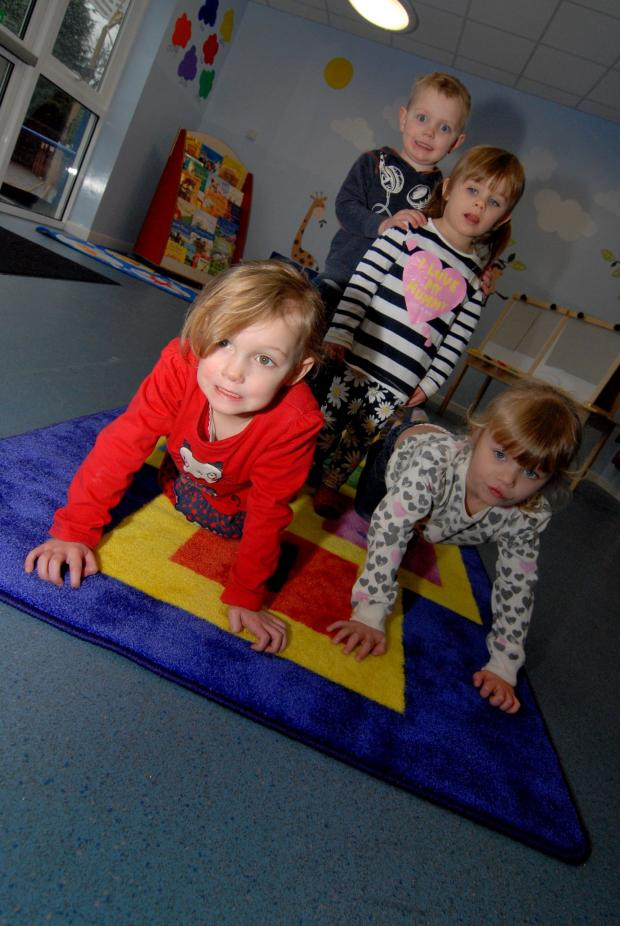 Worcester News: 14/02/14. Callow End Primary School has received a £1,500 grant from Powick Parish Council to help set up a new pre-school group. Left to right - Harriet Ray aged 4, Connor Napierski 3, Emileigh Humphries 3 and Frankie Humphries 3. Picture by Nick T