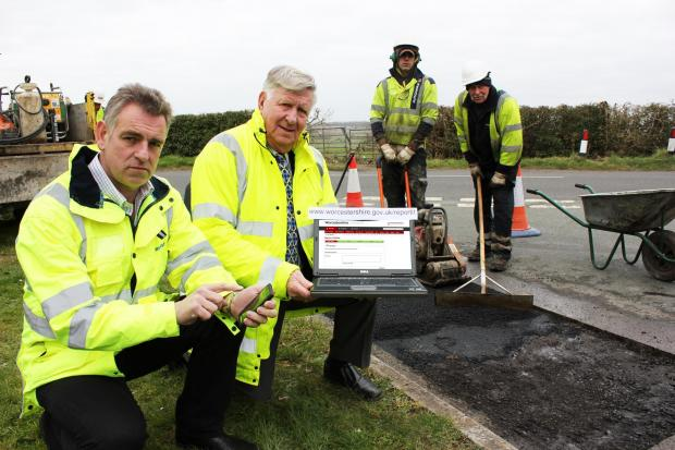 Jon Fraser, County Council Highways Customer and Community Manager and Cllr John Smith OBE, Cabinet Member for Highways and Transport join a repair gang fixing potholes