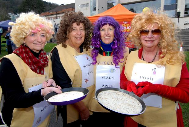 Worcester News: 18/02/14. Malvern Rotary Club annual fundraising pancake races in Priory Park, Malvern. Left to right - Joan Gibson, Linda Foxhall, Katherine Bannister and Sylvia Miles, called themselves The Spice Girls. Picture by Nick Toogood. (4099487)