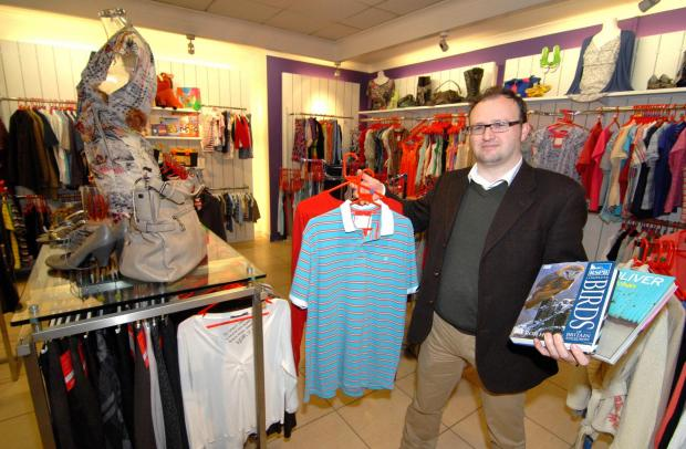 19/02/14. Retail Area Manager at YMCA James Preece inside the new YMCA charity shop in Church Street, Malvern. Picture by Nick Toogood. (4212830)