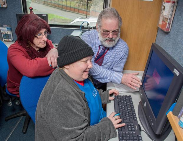 (from left) Nexus Housing residents Michelle Doidge-Woodhouse and Tracey Woodhouse pictured with Community Tutor Michael Merritt aboard the computer bus.