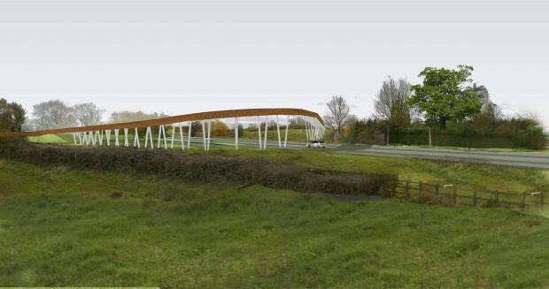 Worcester News: An indicative image of how the bridge over Broomhall Way in Worcester might look. Applicants St Modwen say this is not representative of the final design.