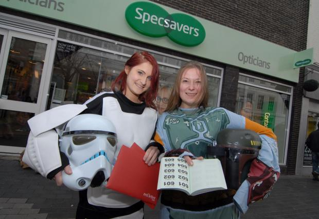 0914532901. 01/03/14. Specsavers in Broad Street, Worcester held a Red Letter Day raffle in aid of Fort Royal Community Primary School. Left to right - staff members Sophie Martin and Hannah Hadley. Picture by Nick Toogood. (4333760)