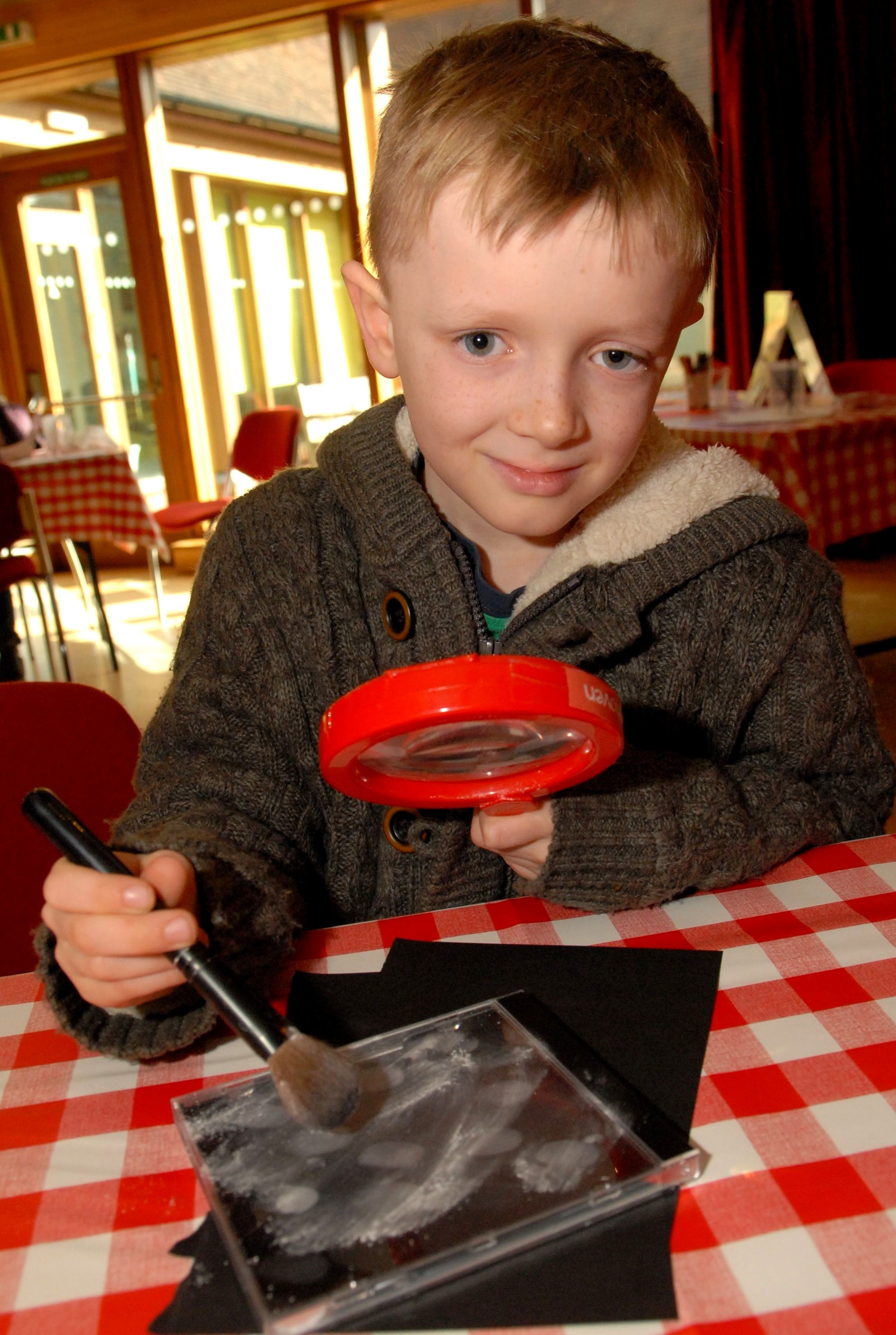 0814525801 Paul Jackson 20.02.14 Lower Broadheath Jacob Hardie, eight, dusts for fingerprints at Elgar Birthplace Museum. (4150822)