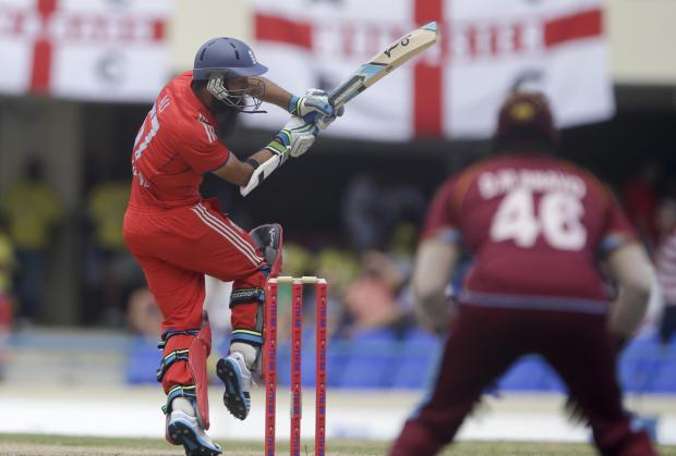 Worcester News: England's Moeen Ali bats during the second one-day international cricket match against West Indies at the Sir Vivian Richards Cricket Ground in St. John's, Antigua, Sunday, March 2, 2014. (AP Photo/Ricardo Mazalan). (4340592)
