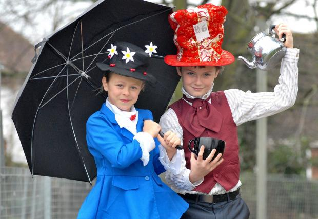 Worcester News: MAD HATTER: Perdiswell Primary School pupils Mia Mandrell, nine, as Mary Poppins and Ben Sparrow, 11, as the Mad Hatter, for World Book Day. Picture by Nick Toogood. 1014537801.