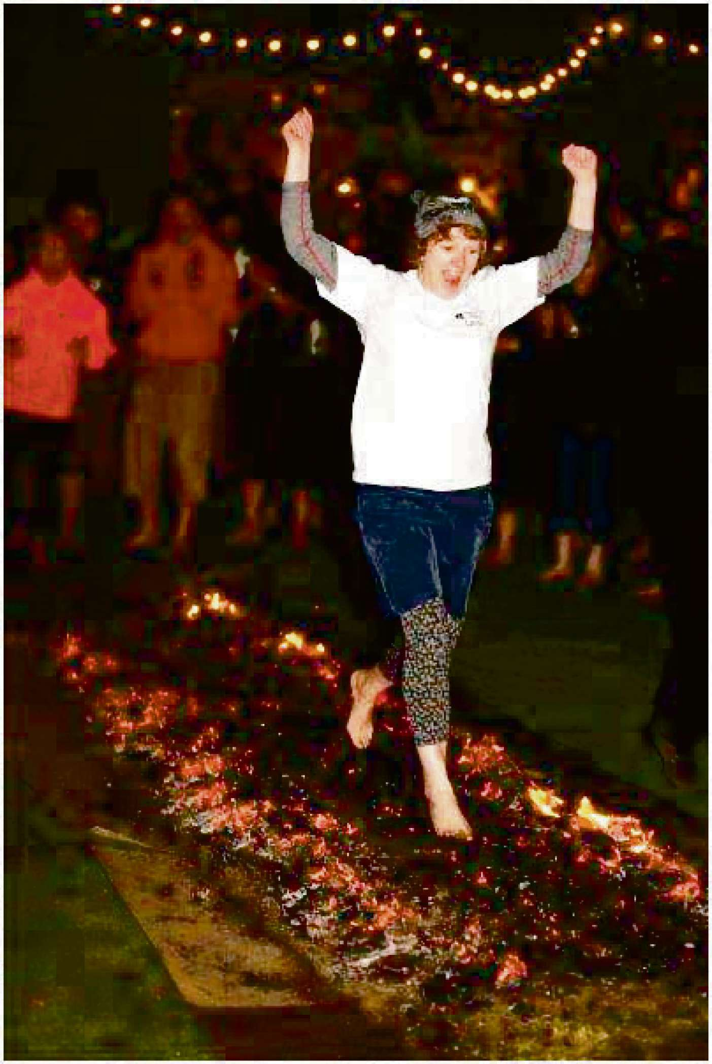 Lynne braves the firewalk for charity