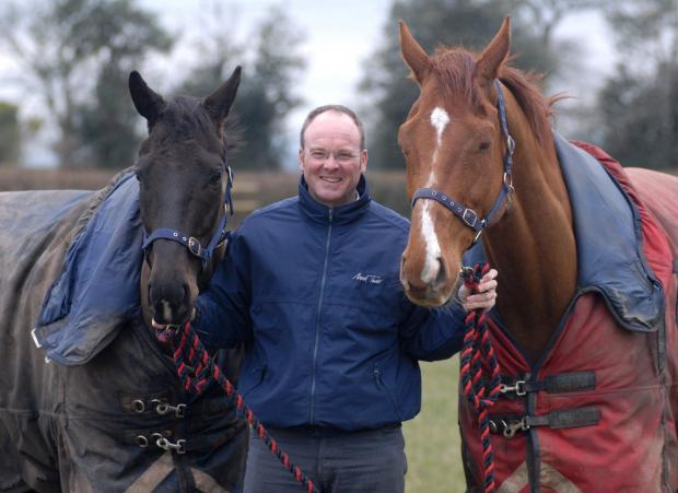 HIGH HOPES: Claines trainer Dr Richard Newland with two of his horses, Act of Kalanisi (left) and Night Alliance, who will be among his runners in next week's Cheltenham Festival. Picture: NICK TOOGOOD. 1014538001.