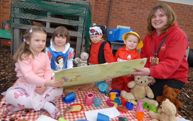 Picnic: Children at Stick Fingers Playgroup and Preschool were joined by their parents for a picnic lunch to celebrate World Book Day. Libby Whing, aged four, Florence Veale, aged four, Spencer Townley, aged three, and Samuel T